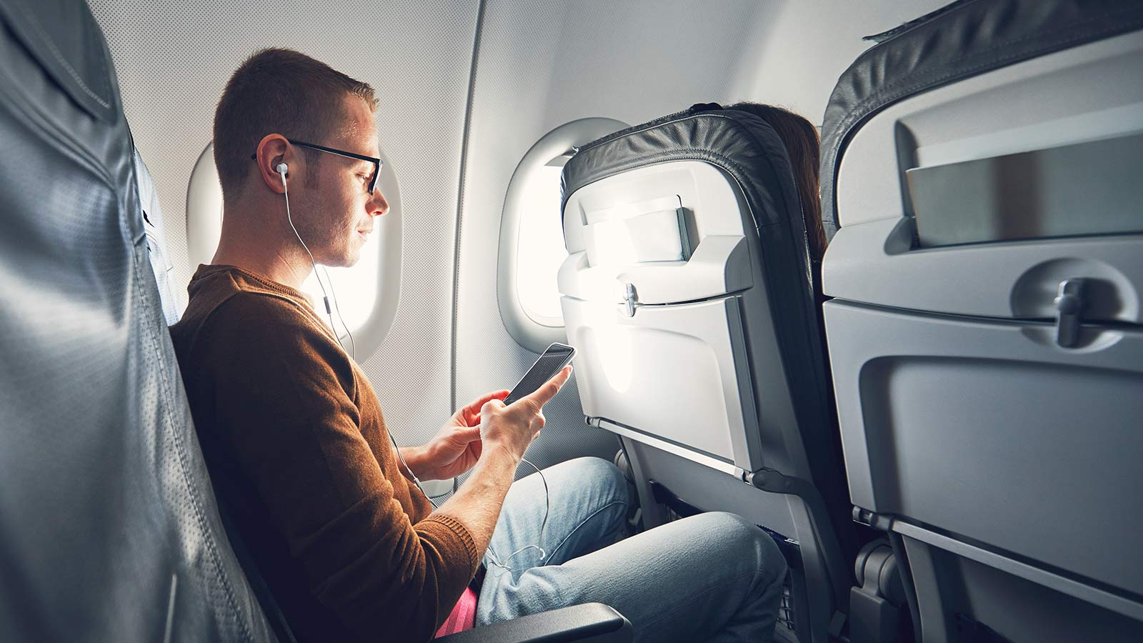 Man listening to music during flight