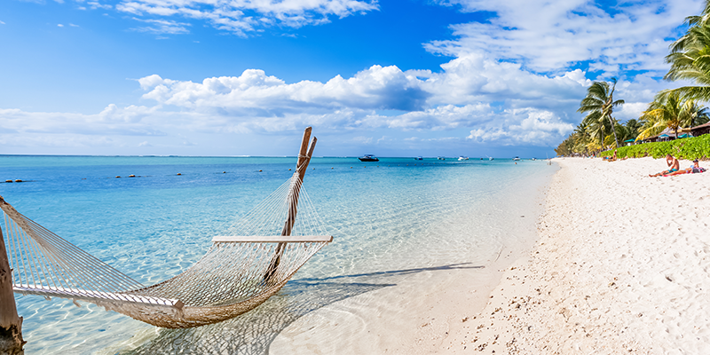 rope hammock over the shallow waters on the Caribbean islands