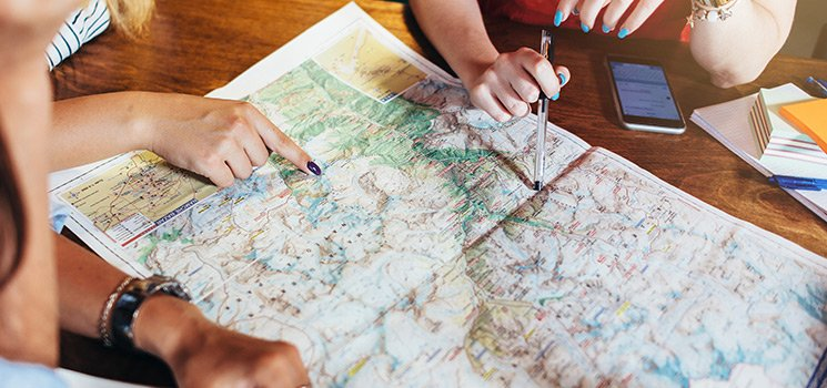 Close-up of hands pointing on map